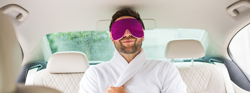 man wearing dressing gown sitting in car